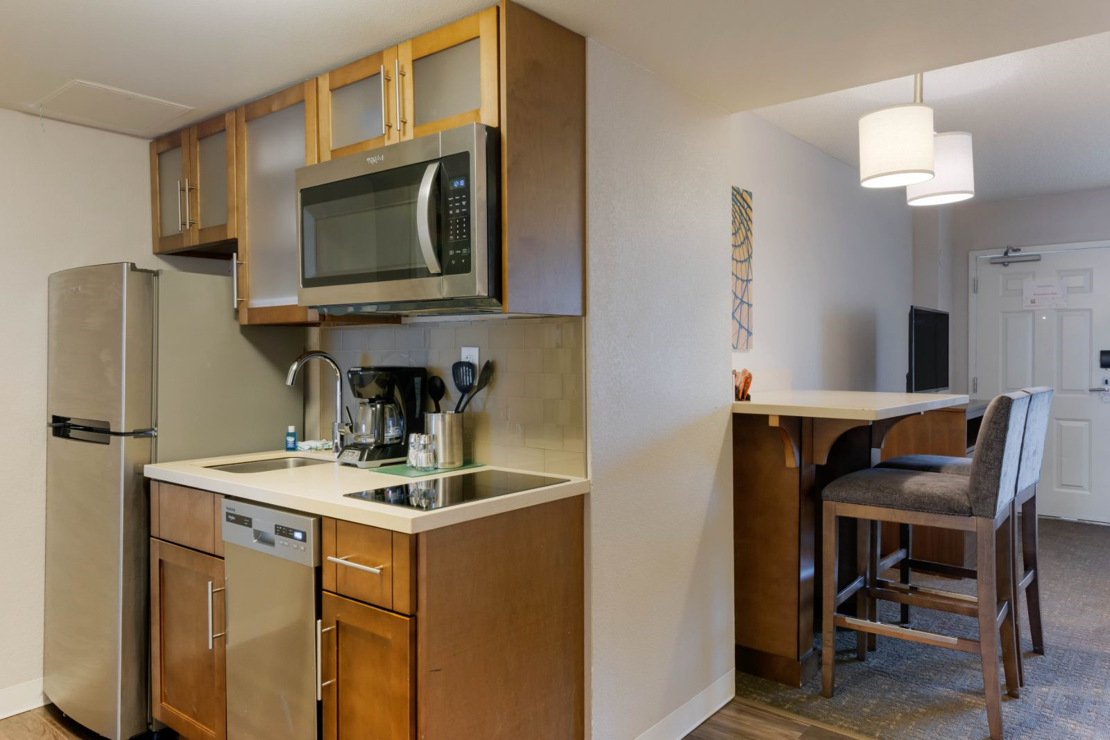 Newly renovated kitchen and dining area in one of our Orlando Hotel Suites